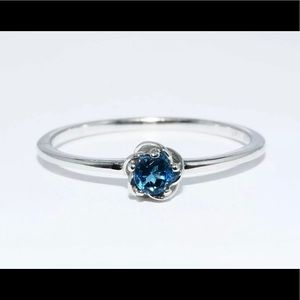 Jewelry - NWOT 10k WG Natural .17ctw blue topaz ring